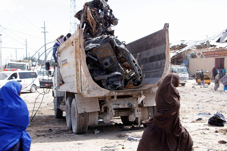 A truck carries wreckage of a car used in a car bomb in Mogadishu, Somalia, Saturday, Dec. 28, 2019. A truck bomb exploded at a busy security checkpoint in Somalia's capital Saturday morning, authorities said. It was one of the deadliest attacks in Mogadishu in recent memory. (AP Photo/Farah Abdi Warsame)