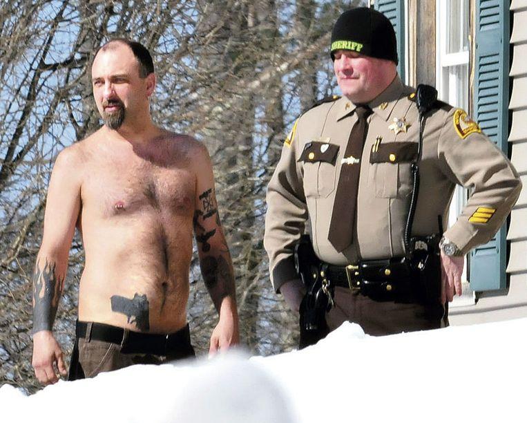 Michael Smith (links) en zijn tatoeage die veel misbaar veroorzaakte.