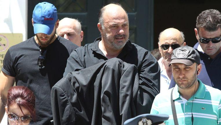 Achilleas Beos (midden), eigenaar van Olympiakos Volos, werd in juni gearresteerd. © ARCHIEF AFP Beeld