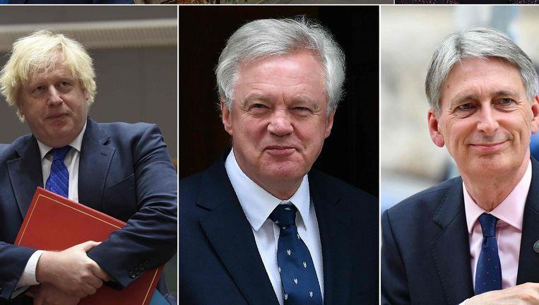 Britse ministers Boris Johnson (Buitenlandse Zaken), David Davis (Brexit), en Philip Hammond (Financiën) Beeld afp
