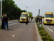 Beschonken scooterbestuurder en agent lagen samen buiten westen op de Brugweg