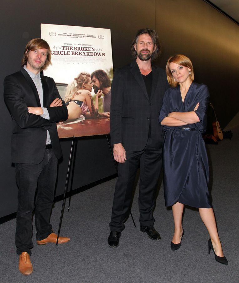 Regisseur Felix van Groeningen met hoofdrolspelers Johan Heldenbergh en Veerle Baetens van The broken circle breakdown. Beeld getty