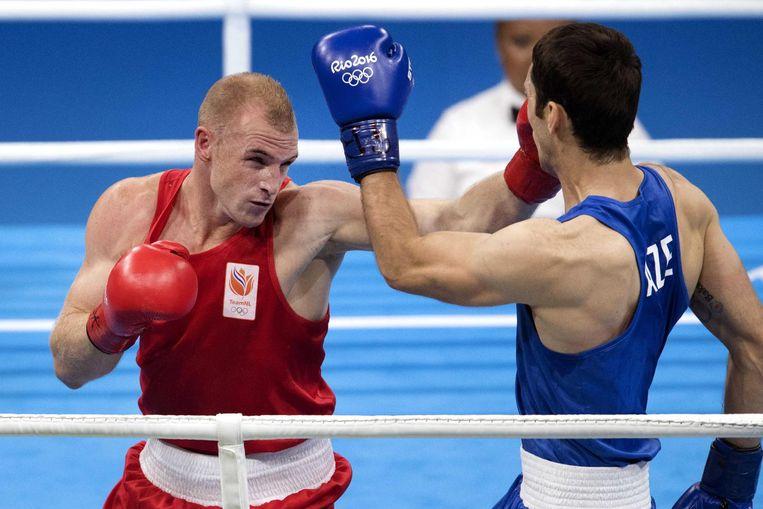 Peter Mullenberg verliest tegen Teymur Mammadov uit Azerbeidzjan op het Olympische bokstoernooi in Rio. Beeld null