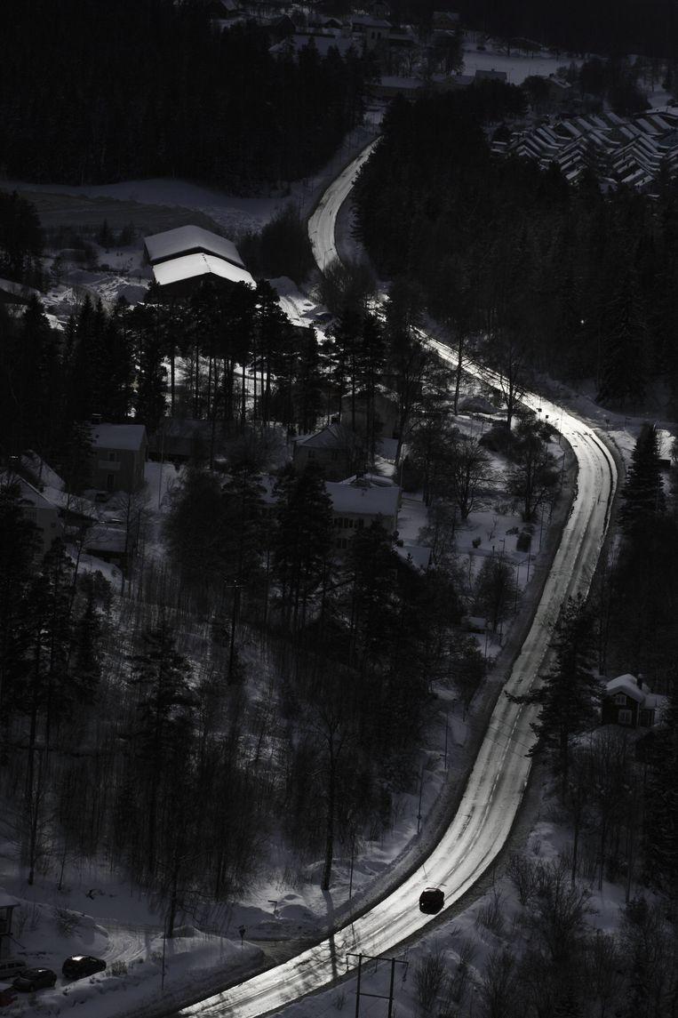 Het optimisme wil Zweden in de lange wintermaanden wel eens verlaten. Fotograaf Lars Tunbjörk legde de sfeer vast in een serie. Beeld Hollandse Hoogte / Nordic Photos ehf