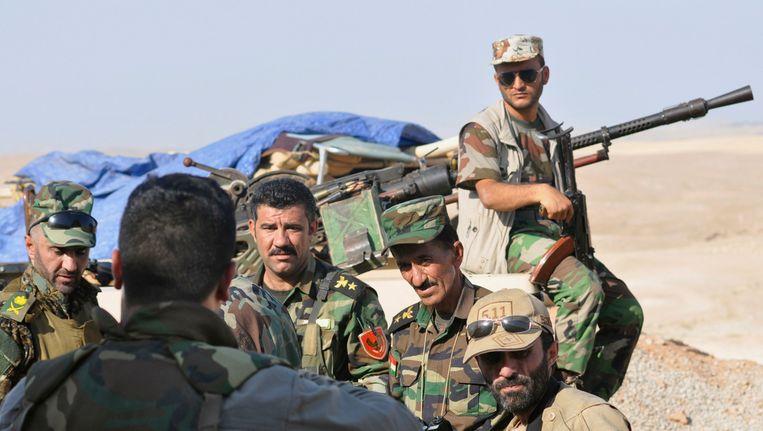Koerdische peshmerga-milities houden de wacht Beeld REUTERS
