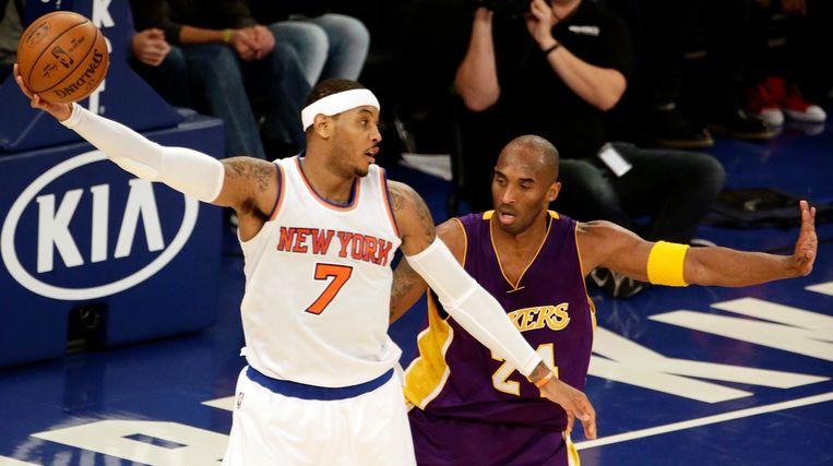Carmelo Anthony (links) in duel met Kobe Bryant. Beeld epa