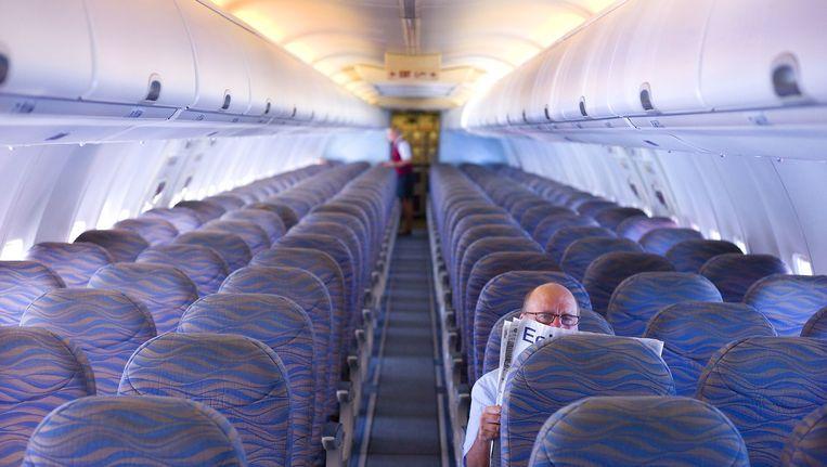 Een nagenoeg leeg vliegtuig van Corendon, dat in 2013 ook al Nederlanders terughaalde uit het toen onrustige Egypte Beeld anp