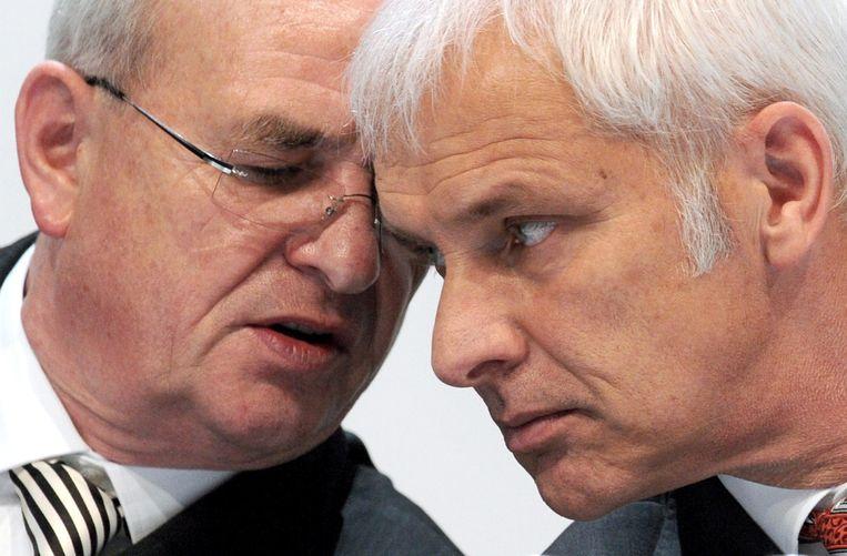 Martin Winterkorn (L) en Matthias Müller (R) in 2011. Beeld epa