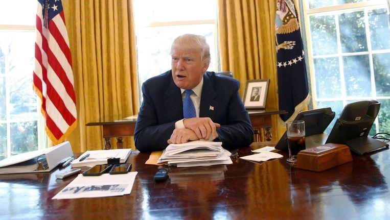 Trump in het Oval Office, zijn officiële kantoor in het Witte Huis