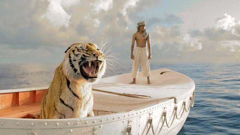 Pi (Suraj Sharma) en de Bengaalse tijger Richard Parker in Life of Pi. Beeld