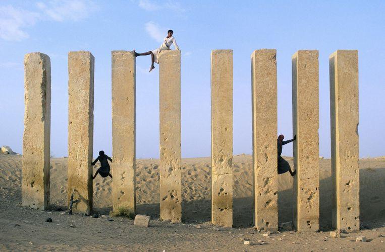 Kinderen spelen bij de Mahram Bilkis tempel Beeld Christophe Boisvieux