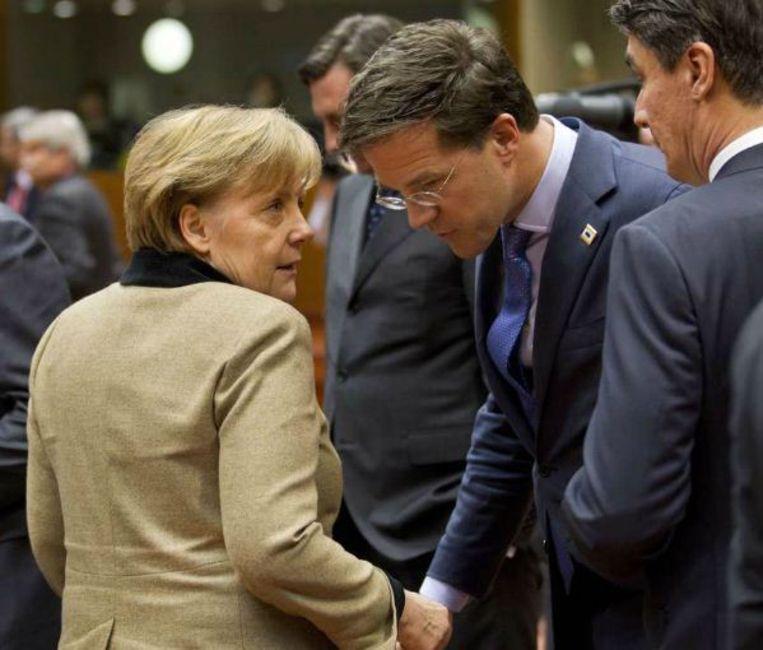 Angela Merkel met Mark Rutte. Beeld epa