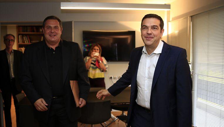 Links Panos Kammenos (Onafhankelijke Grieken) en Alexis Tsipras. Beeld ap