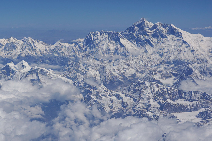 This photo taken on April 27, 2019 shows an aerial view of Mount Everest (centre R) taken during a flight from Nepal to Bhutan. (Photo by Sarah LAI / AFP)