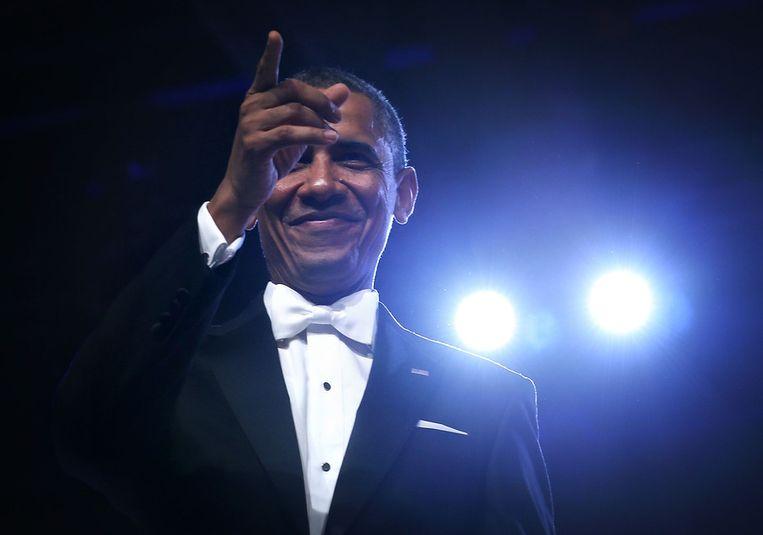 De Amerikaanse president Barack Obama gisteravond na de dans met zijn vrouw Michelle. Beeld getty