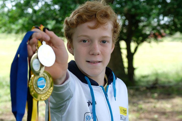 Kilan met zijn zilveren medaille (Belgisch kampioenschap) en twee gouden medailles (Antwerps en Vlaams kampioenschap)