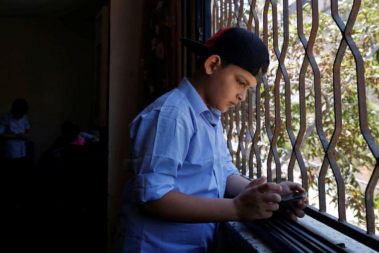 Abdel-Rahman Al-Shantti, de 11-jarige Gaza-rapper. Beeld Reuters
