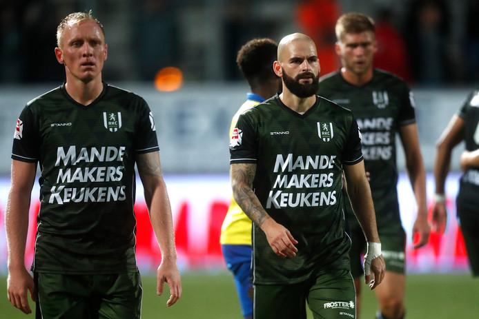 Henrico Drost (l) en Hans Mulder (r) druipen af na de 2-0 nederlaag van RKC bij Cambuur.