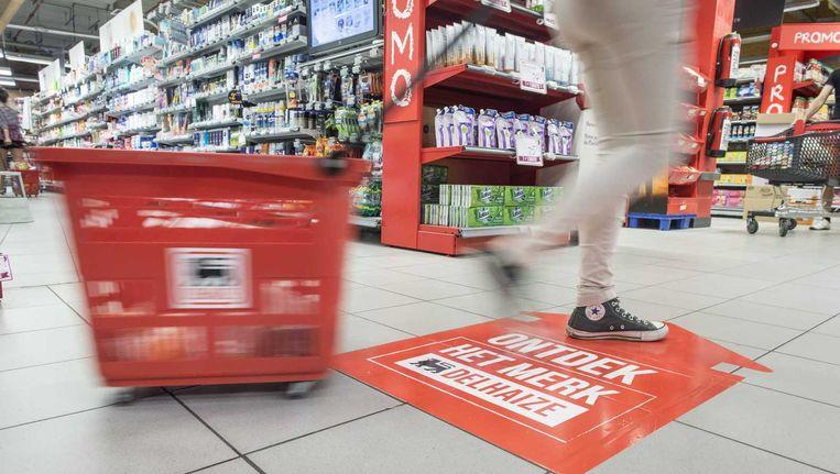 Een winkelmandje in een vestiging van Delhaize in Antwerpen. Beeld anp