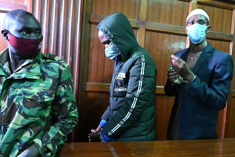 De veroordeelde Hussein Mustafa (midden) en Mohammed Ahmed Abdi (rechts) in de rechtbank. Beeld Hollandse Hoogte / AFP