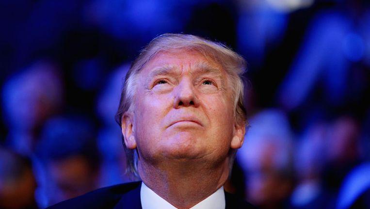 Donald Trump tijdens een bokswedstrijd in Madison Square Garden in New York. Dinsdag wordt in Las Vegas het laatste Republikeinse debat van dit jaar gehouden. Beeld Getty