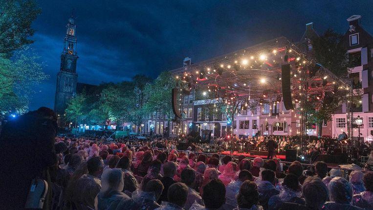 Bezoekers kijken vanaf hun boten naar concerten Beeld ANP