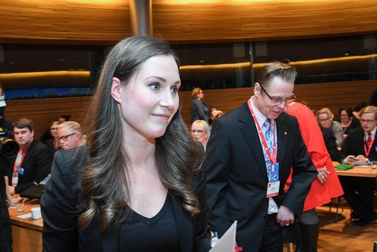 Sanna Marin op het congres van de Finse Sociaal/democraten waar zij afgelopen weekeinde werd gekozen als opvolger van premier Antti Rinne. Hij kondigde vorige week zijn aftreden aan. Marin wordt de jongste premier die Finland ooit heeft gehad.  Beeld EPA