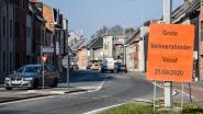Nieuwe asfaltlaag en fietssuggestiestroken op Zandstraat in Appels