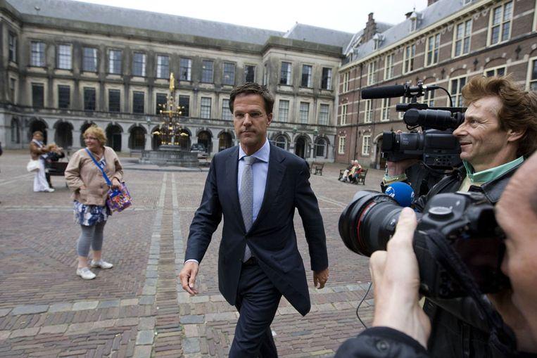 VVD-leider Mark Rutte op het Binnenhof, vlak voor zijn gesprek met informateur Rosenthal, waarin hij liet weten dat zijn partij wil aansturen op een kabinet van VVD, PvdA en CDA. (ANP) Beeld