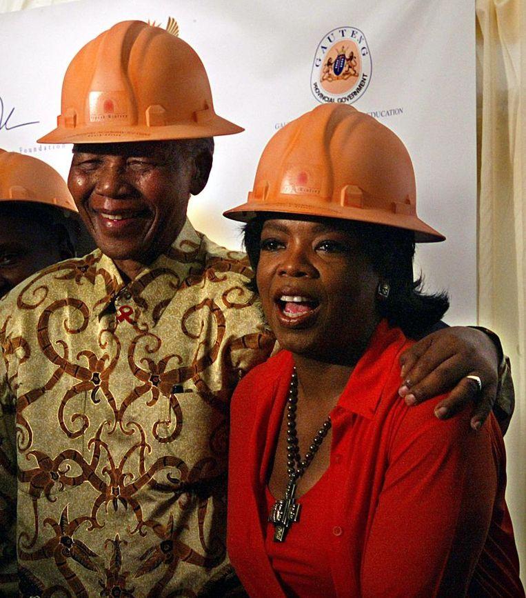 Winfrey en Mandela in 2002. Beeld afp