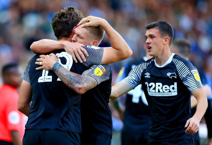 Derby County's Martyn Waghorn (centre) hugs team mate Chris Martin at the end of the Sky Bet Championship match at Elland Road, Leeds.