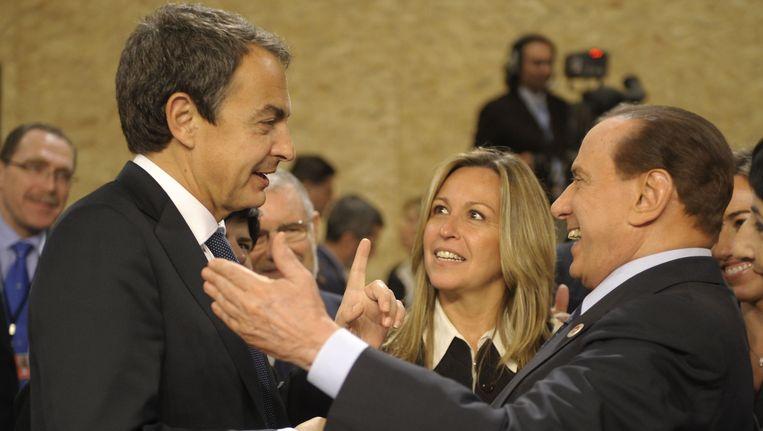 Zapatero (links) en Berlusconi. Beeld AFP
