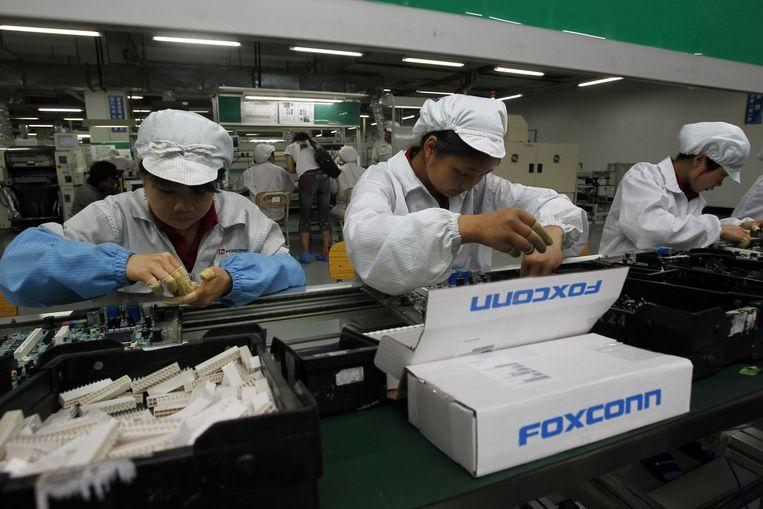 Een fabriek in Shenzhen van elektronicaproducent Foxconn, die onder meer de iPhone van Apple in elkaar zet, mocht nog niet openen van de plaatselijke autoriteiten.
