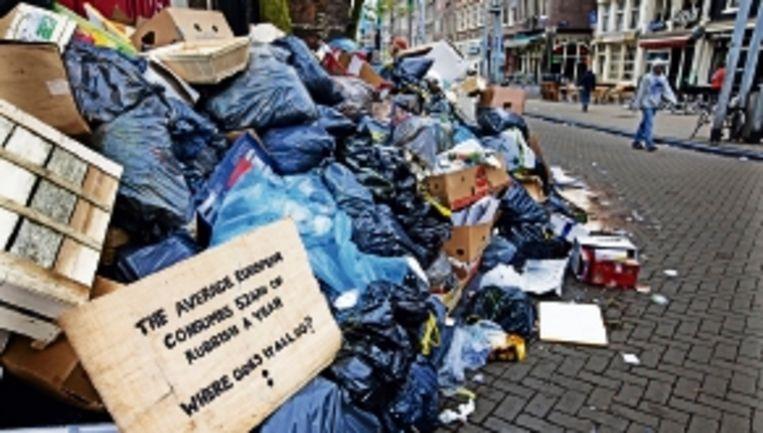 'Loonsverhoging na vuilnisstakingen wekt verbazing.' (FOTO ANP) Beeld