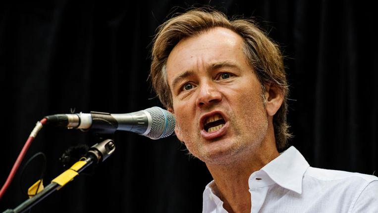 Hoogleraar Ewald Engelen geeft een toespraak tijdens het protest tegen TTIP op het Beursplein Beeld anp