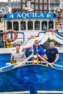 In Scheveningen, op de Aquila, met van links naar rechts: Ben Oortwijn, schipper Willem Schouwenaars en Pascal van Erp.