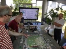 Bordspel over windmolens en zonne-energie in Apeldoorn