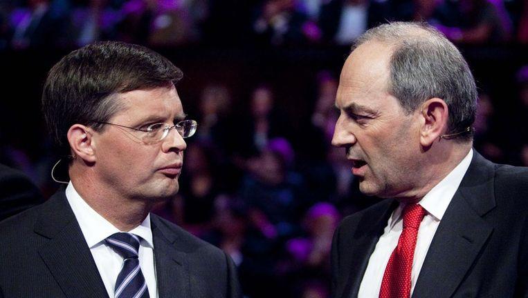 CDA-leider Jan Peter Balkenende (L) en PvdA-leider Job Cohen (R) woensdag tijdens het lijsttrekkersdebat in theater Carre in Amsterdam. Foto ANP Beeld