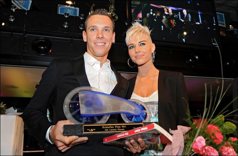 Philippe Gilbert met vrouw Patricia na zijn overwinning in 2011.