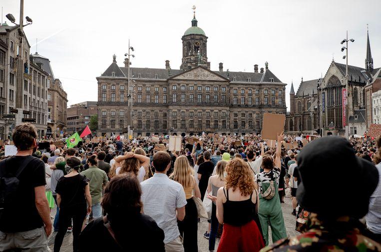 Demonstranten tijdens het protest tegen racisme op de Dam. Beeld Hollandse Hoogte /  ANP