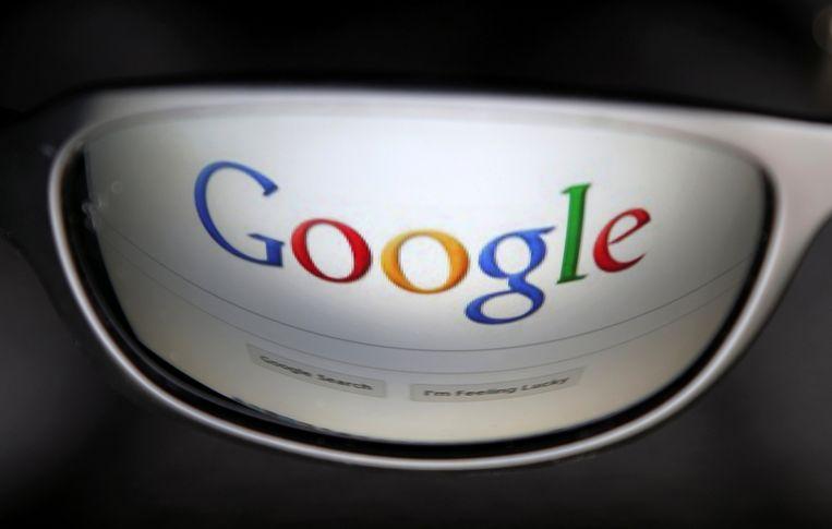 De startpagina van Google gereflecteerd in een bril. Foto ter illustratie.