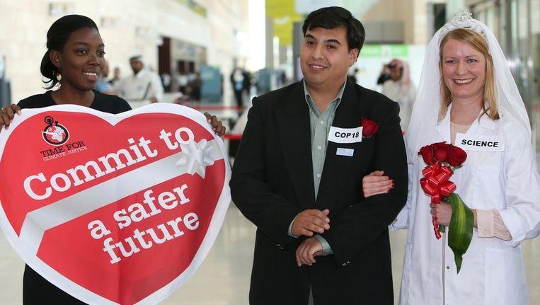 Activisten tijdens de klimaattop in Doha. Beeld afp