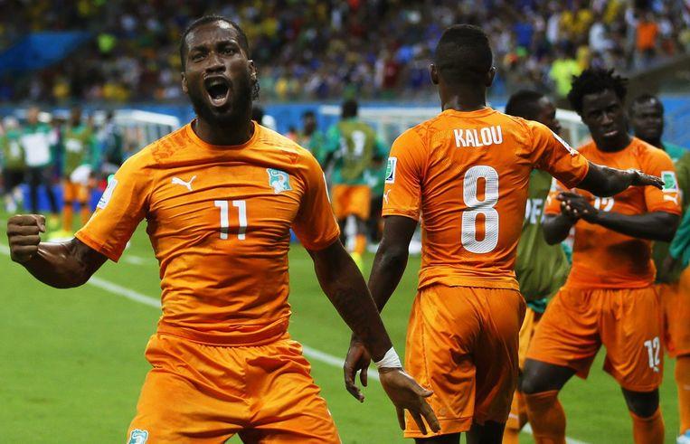 Sterspeler Didier Drogba juicht nadat Ivoorkust gescoord heeft tegen Japan op het WK voetbal in Brazilie. Beeld epa