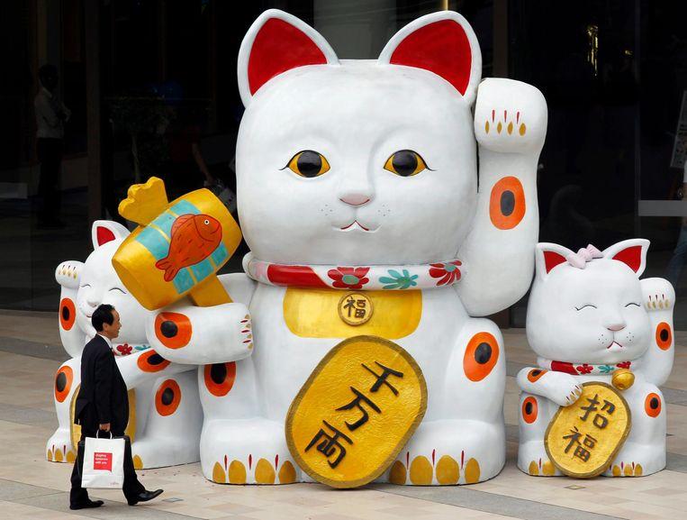 Het zwaaiende katje bij de Chinees blijkt hartstikke Japans. Beeld afp