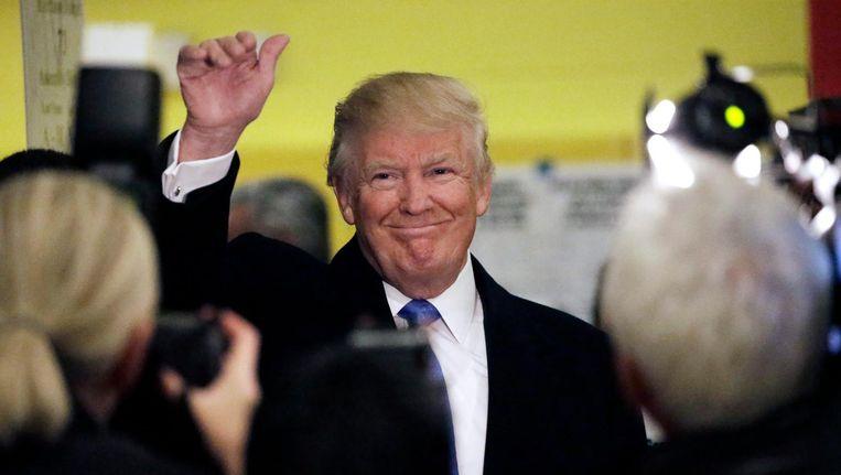 Trump nadat hij zijn stem heeft dinsdag uitgebracht. Beeld AP