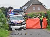 Scooterrijder overleden na botsing politiewagen in Heukelom