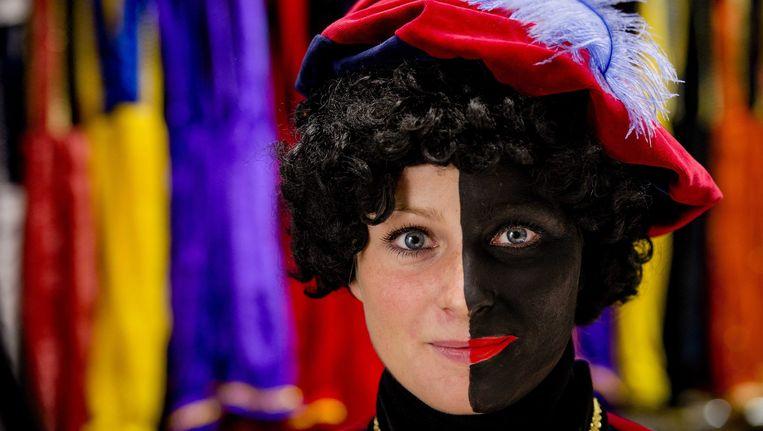 Een halfgeschminkte Zwarte Piet. Beeld epa