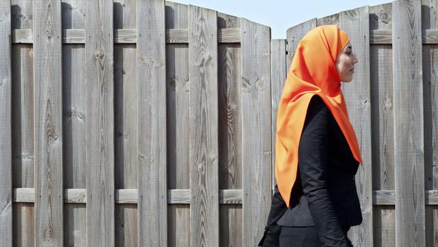 Archiefbeeld van een moslima met hoofddoek.