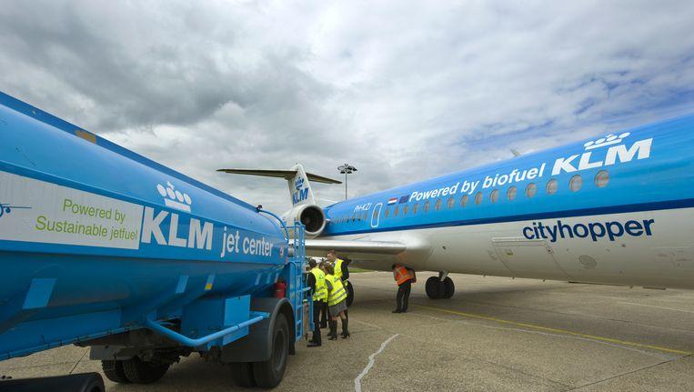 Een Fokker 70 Cityhopper op Schiphol. Beeld anp
