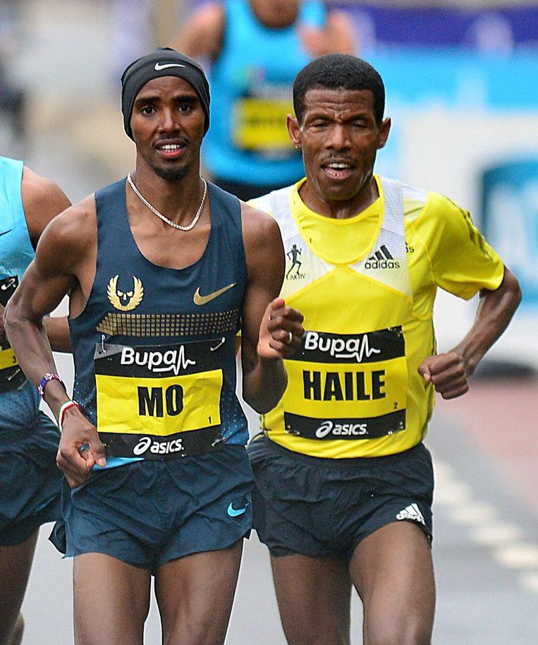 Mo Farah en Haile Gebrselassie. Beeld BSR Agency